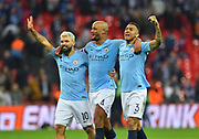 Manchester City are Carabao Cup champions - Sergio Aguero (10) of Manchester City, Vincent Kompany (4) of Manchester City and Danilo (3) of Manchester City celebrate after winning a penalty shootout after a 0-0 draw after extra time during the Carabao Cup Final match between Chelsea and Manchester City at Wembley Stadium, London, England on 24 February 2019.