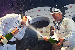 John Kostecki sprays James Spithill with Champagne<br /> BMW Oracle wins the America's Cup<br /> 2010 America's Cup, Valencia<br /> ©2010 Kaufmann/Forster go4image.com