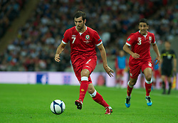 LONDON, ENGLAND - Tuesday, September 6, 2011: Wales' Joe Ledley and Neil Taylor in action against England during the UEFA Euro 2012 Qualifying Group G match at Wembley Stadium. (Pic by Gareth Davies/Propaganda)