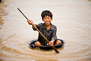 28 JUNE 2006 - CHONG KHNEAS, SIEM REAP, CAMBODIA: A boy in a floating tub in the floating village of Chong Khneas, at the northwest end of Tonle Sap Lake, Cambodia's vast inland sea. More than 2,500 people live on the lake in houses that move as the lake expands and contracts with the seasons. During the dry season the lake covers about 2,500 square kilometers. At the peak of the rainy season the Tonle Sap swells to more than 13,000 square kilometers. Photo by Jack Kurtz / ZUMA Press