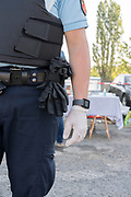 police officer wearing surgical gloves during Covid 19 crisis and lockdown France Limoux April 2020