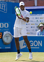 Tennis - 2017 Aegon Championships [Queen's Club Championship] - Day Three, Wednesday<br /> <br /> Men's Singles, Round of 16 -Viktor TROICKI (SRB) Vs Donald YOUNG (USA)<br /> <br /> Donald Young (USA) returns serve on centre court at Queens Club <br /> <br /> <br /> COLORSPORT/DANIEL BEARHAM