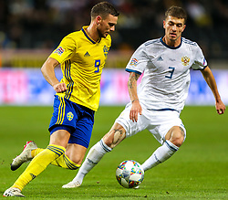 November 21, 2018 - Stockholm, Sweden - Marcus Berg of Sweden (L) and Roman Neustadter of the Russia vie for the ball during the UEFA Nations League B group two match between Sweden and Russia at Friends Arena on November 20, 2018 in Stockholm, Sweden. (Credit Image: © Igor Russak/NurPhoto via ZUMA Press)