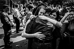 A conscript embraces his sisters, before he leaves to serve in the Russian army at a recruiting station in Moscow, Russia, 13 May 2012.