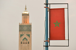 June 25, 2017 - Casablanca, Morocco - The Maroccan and Hassan II mosque minaret in Casablanca hours only from the start of Eid Al Fitr celebrations ..The holy feast of Eid Al Fitr in Morocco will be celebrated from Monday morning..On Sunday, June 25, 2017, in Casablanca, Morocco..Photo by Artur Widak  (Credit Image: © Artur Widak/NurPhoto via ZUMA Press)