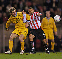 Photo. Jed Wee.<br /> Sunderland v Preston North End, Nationwide League Division One, Stadium of Light, Sunderland. 10/03/2004.<br /> Sunderland's Jeff Whitley (R) and Preston's Richard Cresswell grapple for possession.