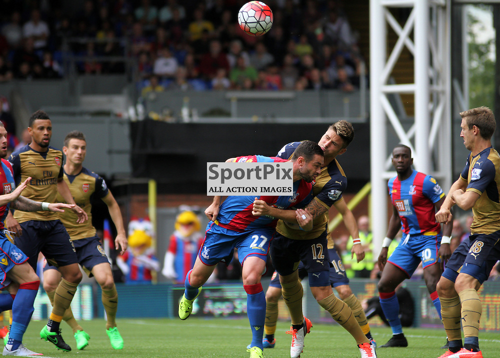 Olivier Giroud wrestles with Damien Delaney early on During Crystal Palace vs Arsenal on Sunday the 16th August 2015.