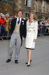 The HON.CAMILLA ASTOR and her fiance DOMINIC TRUSTED at the wedding of Laura Parker Bowles to Harry Lopes held at Lacock, Wiltshire on 6th May 2006.<br />