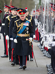 SAND HURST - UK - 11- DEC-2015: HRH The Prince of Wales attends and takes the Royal Salute  during the Sovereigns Parade at the Royal Military College, Sandhurst.<br /> Photograph by Ian Jones
