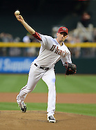 PHOENIX, AZ - APRIL 26:  Pitcher Brandon McCarthy #32 of the Arizona Diamondbacks pitches against the Colorado Rockies in the first inning at Chase Field on April 26, 2013 in Phoenix, Arizona.  The Rockies defeated the Diamondbacks 6 to 3.  (Photo by Jennifer Stewart/Getty Images)