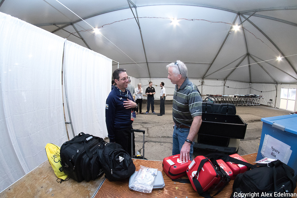 Dr. Roth (left) and Jeff's father Scott (right) discuss the AED unit's that Dr. Roth and the race staff planned to deploy along the race course.