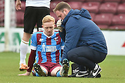 Luke Williams of Scunthorpe United receives treatment for injury during the Sky Bet League 1 match between Scunthorpe United and Colchester United at Glanford Park, Scunthorpe, England on 23 January 2016. Photo by Ian Lyall.