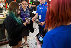 © Licensed to London News Pictures. 19/09/2014. Apple staff liaise customers waiting in line for the iphone 6 with at the Apple Store in Chadstone Melbourne Australia. Australia is one of the first countries in the world to sell the iphone 6 due to geographic location & time zone. Photo credit : Asanka Brendon Ratnayake/LNP