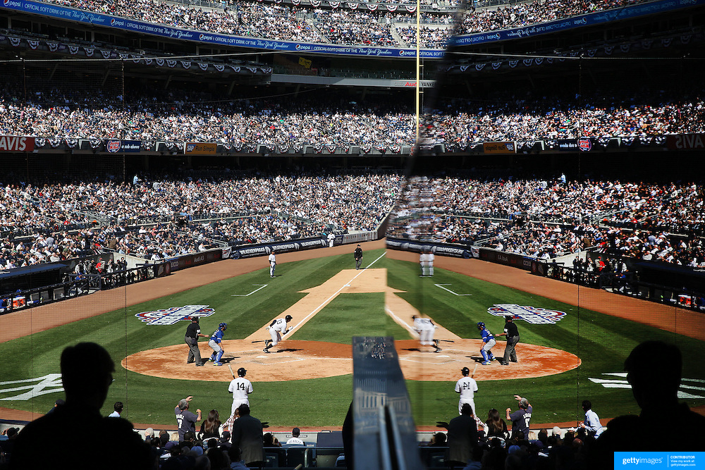 Time to reflect...Alex Rodriguez gets his first hit back in a Yankees uniform after his year long ban as he hits a single during the New York Yankees Vs Toronto Blue Jays season opening day at Yankee Stadium, The Bronx, New York. 6th April 2015. Photo Tim Clayton