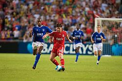 Hong Kong, China - Friday, July 27, 2007: Liverpool's Xabi Alonso and Portsmouth's Sylvain Distin during the final of the Barclays Asia Trophy at the Hong Kong Stadium. (Photo by David Rawcliffe/Propaganda)