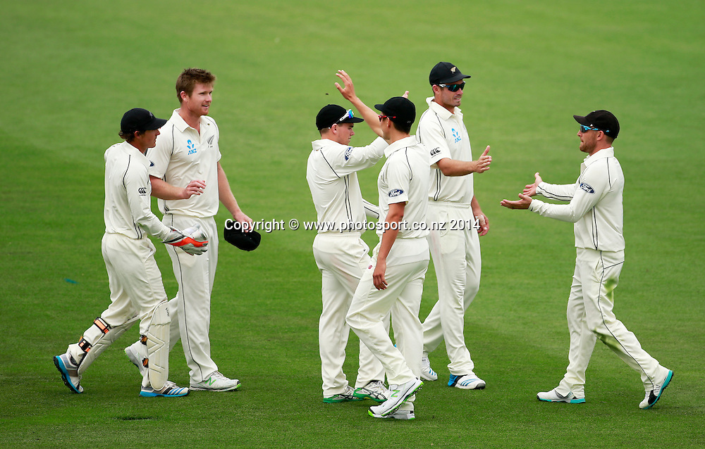 Brendon McCullum of the Black Caps is congratulated by team mates after taking a catch off the bowling of Jimmy Neesham on Day 2 of the boxing Day Cricket Test Match between the Black Caps v Sri Lanka at Hagley Oval, Christchurch. 27 December 2014 Photo: Joseph Johnson / www.photosport.co.nz