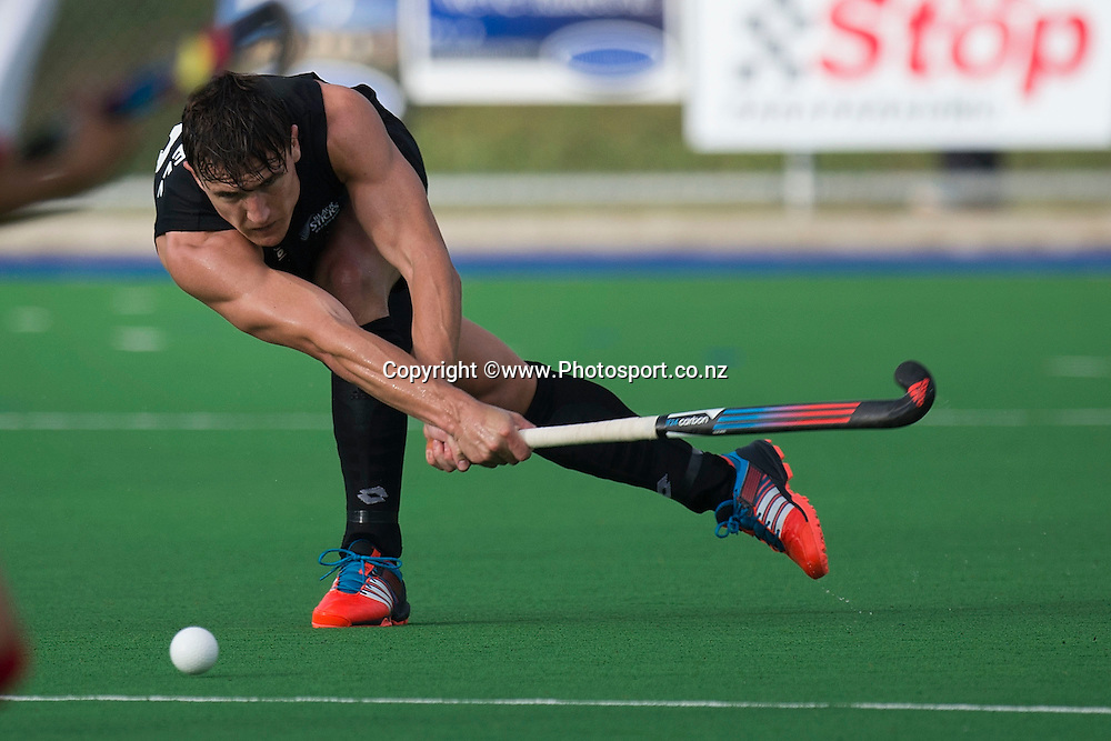 Dwayne Rowsell of New Zealand makes a pass during the Black Sticks Men v Japan international hockey match at the Coastlands Kapiti Sports Turf in Paraparaumu on Saturday the 22nd of November 2014. Photo by Marty Melville/www.Photosport.co.nz