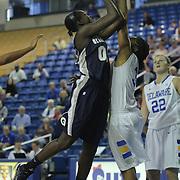 Georgetown Forward Ki-Ke Rafiu (00) shoot over Delaware Guard Jaquetta May (3) during a Quarterfinals Women's National Invitation Tournament Preseason game Sunday, Nov. 11, 2012 at the Bob Carpenter Center in Newark Delaware.