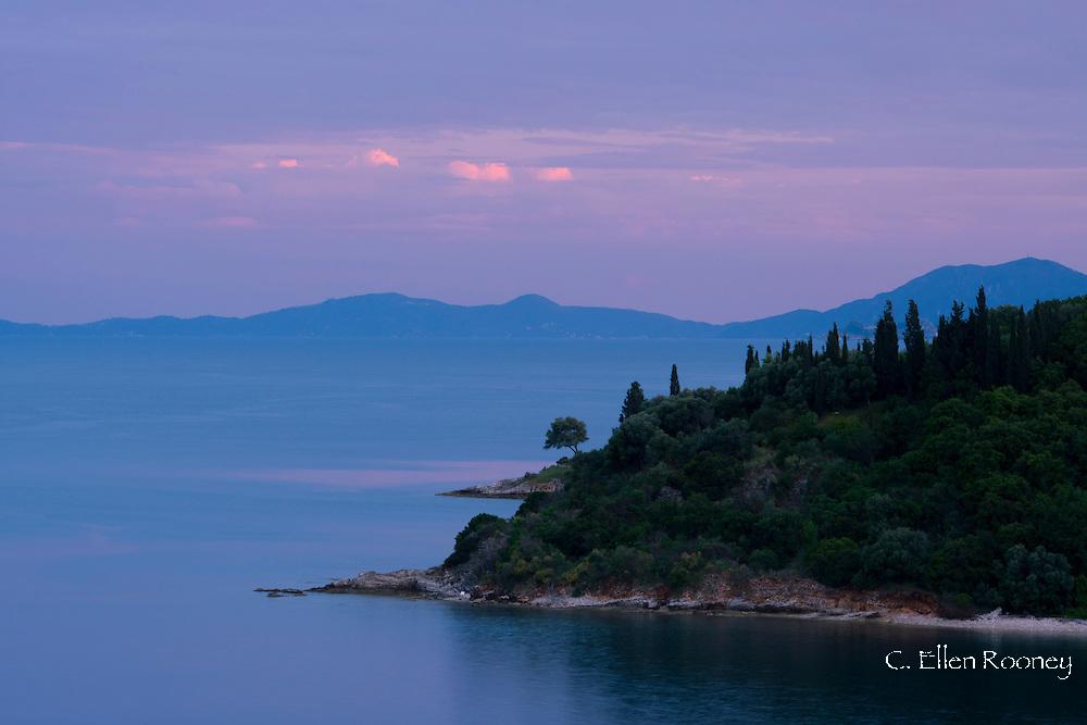 Sunset on the northeast coast of Corfu near Agios Stefanos.  Corfu, The Ionian Islands, Greece