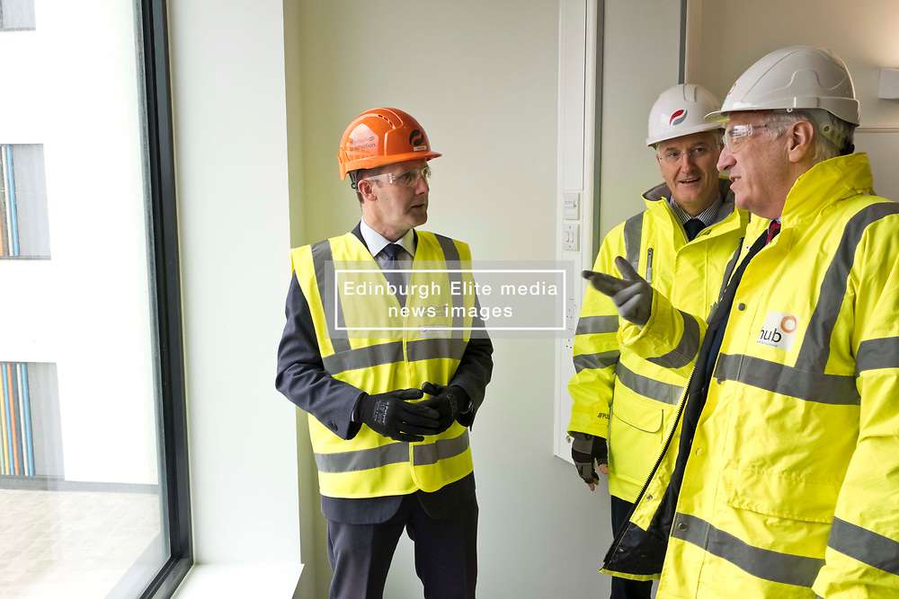 Pictured: Michael Matheson with Hubs' chief Executive Paul McGirk (open jacket) and Morrison Construction's project Director Phil Galbraith<br /> <br /> Infrastructure Secretary Michael Matheson visited East Lothian Community Hospital's construction site today to give an update on the Scottish Government's infrastructure programme, on the same day as an annual progress report is published<br /> <br /> Ger Harley | EEm 17 April 2019