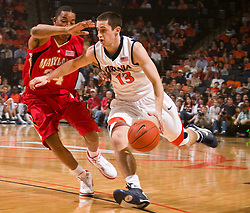 Virginia guard Sammy Zeglinski (13) is defended by Maryland guard/forward Cliff Tucker (24).  The Virginia Cavaliers defeated the Maryland Terrapins 68-63 at the John Paul Jones Arena on the Grounds of the University of Virginia in Charlottesville, VA on March 7, 2009.