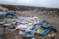 © London News Pictures. 18/01/16. Calais, France. 18/01/16. Frost on abandoned belongings in an rea of the Calais 'Jungle' refugee camp designated for eviction. French authorities are to bulldoze a 100-metre 'buffer zone' between the camp and the adjacent motorway, which leads to the ferry port. Photo credit: Rob Pinney/LNP