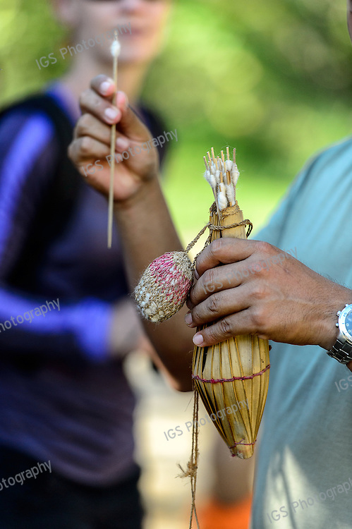 The cargajo, a quiver like basket that holds the blowgun darts (biruta).The Yagua quiver (Cargajo) is made from catirina tree that can be either the palm Orbignya or Scheelea.  Darts are made from the inayuga palm, Maximiliana, a plant bristling with needles and thorns.  The Yagua use the chambira palm nut as the container for the kapok  cotton. Yaguas occasionally attach a jawbone from the piranha fish to the quiver, used to sharpen the darts.
