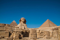 The Sphinx, 2 pyramids and ruins at Giza, Egypt.