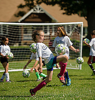 "McKenzie practices her foot skills with the Evangelical Baptist Church ""On Goal"" Soccer Camp at Leavitt Park Thursday morning.  (Karen Bobotas/for the Laconia Daily Sun)"