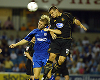Fotball<br /> England 2004/2005<br /> Foto: SBI/Digitalsport<br /> NORWAY ONLY<br /> <br /> Millwall v Wigan<br /> The League Championship. 10/08/2004<br /> <br /> Darren Ward of Millwall and lee McCulloch battle for the ball