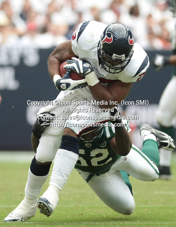 13 September 2009: Running back Steve Slaton #20 of the Houston Texans is tackled by linebacker David Harris #52 at Reliant Stadium on September 13, 2009 in Houston, Texas. The Jets defeated the Texans 24 to 7.