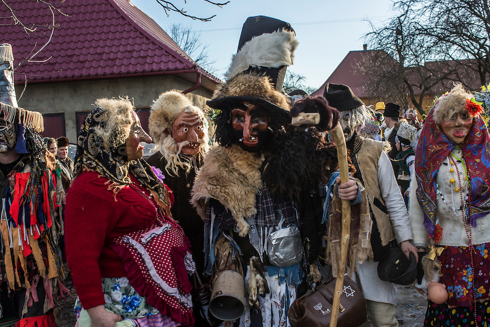 KRASNOILSK, UKRAINE - JANUARY 14: Villagers celebrate the winter festival of Malanka on January 14, 2015 in Krasnoilsk, Ukraine. The holiday, which involves dressing in elaborate costumes and going from house to house as a group singing traditional songs, is celebrated on New Year's Day of the Orthodox calendar, a week after Orthodox Christmas. (Photo by Brendan Hoffman/Getty Images) *** Local Caption ***