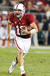 November 6, 2010; Stanford, CA, USA;  Stanford Cardinal quarterback Andrew Luck (12) rushes up field against the Arizona Wildcats during the fourth quarter at Stanford Stadium.  Stanford defeated Arizona 42-17.