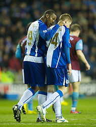 WIGAN, ENGLAND - Tuesday, March 16, 2010: Wigan Athletic's Titus Bramble tries to console James McCarthy after he scored an own goal during the Premiership match at the DW Stadium. (Photo by David Rawcliffe/Propaganda)