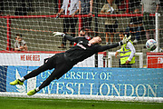 Brentford Goalkeeper Luke Daniels (28) warms-up ahead of the EFL Sky Bet Championship match between Brentford and Queens Park Rangers at Griffin Park, London, England on 21 April 2018. Picture by Stephen Wright.