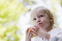 Portrait of young girl 91-2) eating apple
