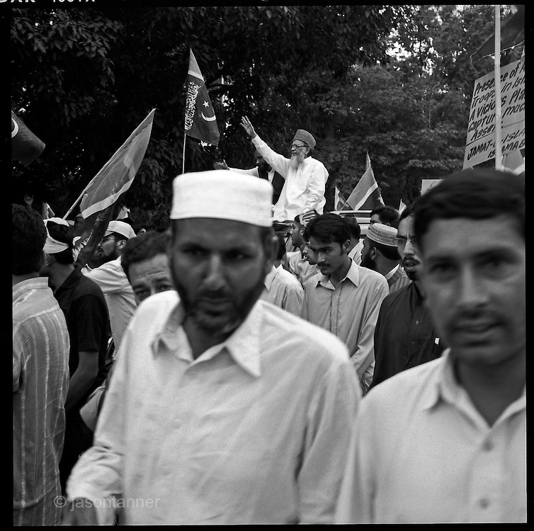 Islamabad: Pakistani Jamaat-e-Islami party leader Syed Munawwar Hassan leads a demonstartion along with supporters towards the US embassy in Islamabad...The demonstration was organised in protest against the proposed expansion of the US embassy and deployment of up to 1000 US Marines to guard it. Approximately 4000 JI supporters marched demanding an end to US drone attacks and calling for negotiation for peace in tribal belt.