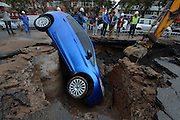 LANZHOU, CHINA - SEPTEMBER 09: (CHINA OUT) <br /> <br /> Car Falls Into Collapsed Road<br /> <br /> A car falls into a hole collapsed on the road on September 9, 2015 in Lanzhou, Gansu Province of China. A car fell into a hole when the road collapsed suddenly at four o\'clock in Wednesday morning. No one got hurt in the accident and the collapsed road was under repair. ©Exclusivepix Media