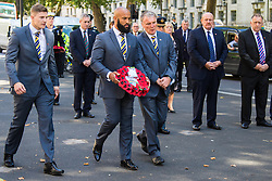 Whitehall, London, August 28th 2015.  Six wreaths are laid at the Cenotaph by representatives from the Armed Forces, the RFL, the Parliamentary Rugby League Group and Ladbrokes Challenge Cup finalists Hull Kingston Rovers and Leeds Rhinos, ahead of Saturday's Ladbrokes Challenge Cup Final at Wembley. PICTURED: Leeds Rhinos Chief Executive Gary Hetherington (R) and players Jamie Jones-Buchanan and Liam Sutcliffe (L) lay their wreath.