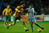 Photo: Daniel Hambury.<br />Coventry City v Norwich City. Coca Cola Championship.<br />26/11/2005.<br />Norwich's Ian Henderson (L) and Coventry's Michael Doyle battle for the ball.