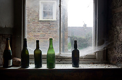 IRELAND KERRY DINGLE 5NOV05 - Empty wine bottles and cobwebs in an old cottage in Inch on the Dingle Peninsula, Irelands most westerly county...jre/Photo by Jiri Rezac..© Jiri Rezac 2005..Contact: +44 (0) 7050 110 417.Mobile: +44 (0) 7801 337 683.Office: +44 (0) 20 8968 9635..Email: jiri@jirirezac.com.Web: www.jirirezac.com..© All images Jiri Rezac 2005 - All rights reserved.