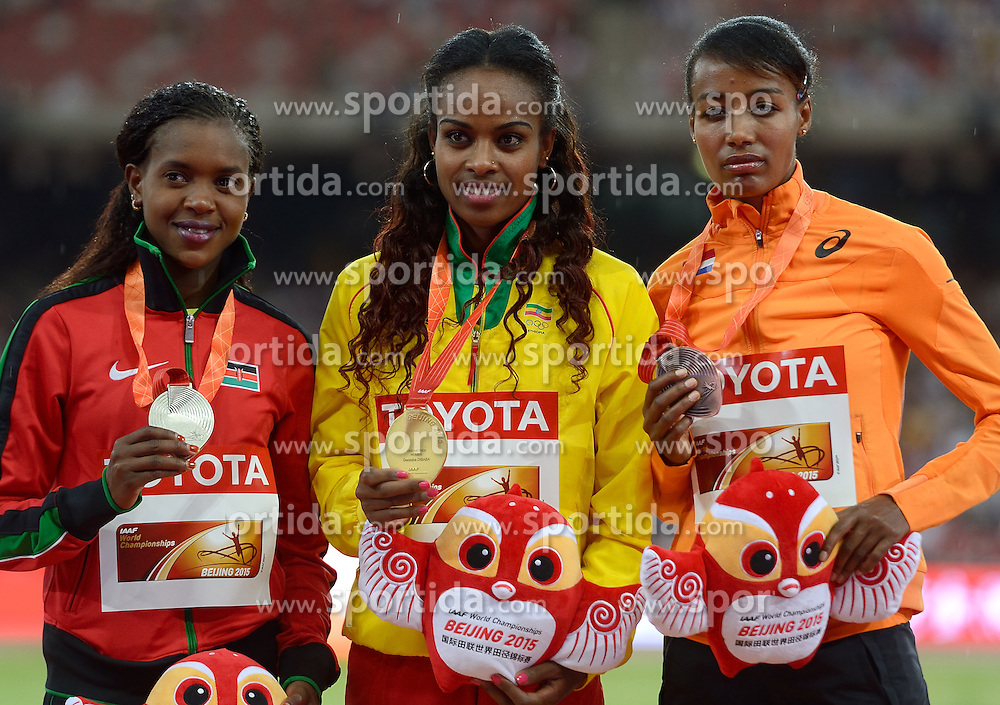 26-08-2015 CHN: IAAF World Championships Athletics day 5, Beijing<br /> Second placed Faith Chepngetich Kipyegon KEN, winner Genzebe Dibaba (ETH)  and third placed Sifan Hassan at medal ceremony of 1500 m Women. Photo by Ronald Hoogendoorn / Sportida