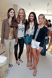 LISA BUTCHER with her daughters OLIVIA DONOSO and AMBER DONOSO and Lisa's niece LAURA BUTCHER (white shorts) at the opening of the new Melissa Odabash store in Walton Street, London SW3 on 7th July 2011.