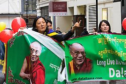 "London, September 21st 2015. Protests by Shugden Buddhists who allege that the Dalai  Lama discriminates against their sect, protest outside the Lyceum Theatre in London as the Dalai Lama attends ""An Afternoon With The Dalai Lama And Friends"" event as part of his UK visit. Loyalists staged a counter protest welcoming the Buddhist leader to London. PICTURED: A Dalai Lama Loyalist makes an obscene gesture as she passed protesting Shugden Buddhists."