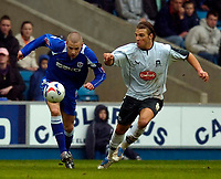Photo: Alan Crowhurst.<br />Millwall v Plymouth Argyle. Coca Cola Championship. 15/04/2006. Alan Dunne (L) attacks for Millwall.