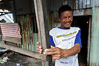 A disabled man, Tallo, Makassar, Sulawesi, Indonesia.