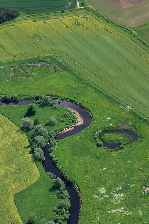 Winding river through fields taken from a microlight in East Lothian, Scotland