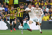 Watford forward Andre Gray (18) battles with Manchester United Midfielder Nemanja Matic during the Premier League match between Watford and Manchester United at Vicarage Road, Watford, England on 15 September 2018.