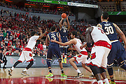 Notre Dame guard Demetrius Jackson shot a three point basket in the second half.<br /> <br /> The University of Louisville hosted the Notre Dame, Wednesday, March 04, 2015 at Yum Center in Louisville. <br /> <br /> Photo by Jonathan Palmer