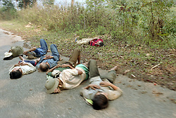 Workers sleeping on a road in the countryside of Dien Bien Phu.